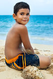 Latin boy on a tropical beach in Cuba Stock Image