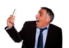 Latin business man laughing with a phone Royalty Free Stock Photos