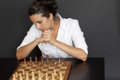 Latin business woman over a chess game Royalty Free Stock Photography
