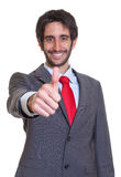 Latin businessman with beard showing thumb Royalty Free Stock Photo