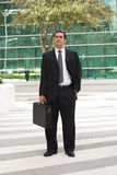 Latin businessman holding briefcase Stock Photos