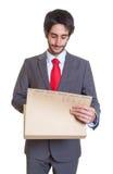 Latin businessman looking at file Royalty Free Stock Photo