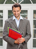 Latin businessman with paperwork in front of his o Stock Photo
