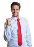 Latin businessman with red tie is happy. On an white background for cut out stock images