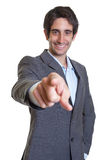 Latin businessman with suit and short hair pointing at camera Stock Photography