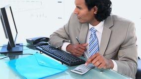Latin businessman using a calculator stock video