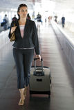 Latin businesswoman at the airport Stock Photography