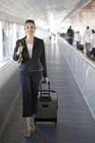 Latin businesswoman at the airport smiling Royalty Free Stock Photography