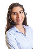 Latin businesswoman with headset laughing at camera Stock Photo