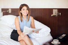 Latin businesswoman reading the news Stock Photos