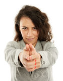 Latin businesswoman taking aim and shooting Royalty Free Stock Photography