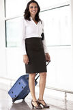 Latin businesswoman travelling Stock Images