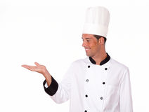 Latin chef holding up his right hand Stock Photo