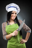 Latin chef woman with knife Stock Images