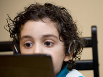 Latin Child Eyes Behind a Screen Stock Images