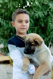Latin child with his dog stock photos