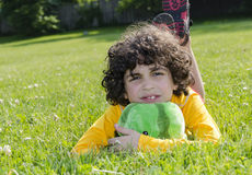 Latin Child Laying on the Grass Stock Photos