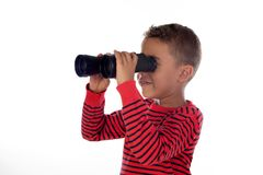 Latin child looking through binoculars. Isolated on a white background stock photo