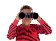 Latin child looking through a binoculars. Isolated on a white background stock images