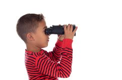 Latin child looking through a binoculars. Isolated on a white background stock photography