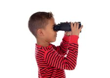 Latin child looking through binoculars. Isolated on a white background royalty free stock photography