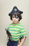 Latin Child with a Pirate Disguise. Hispanic boy playing the pirate with a new disguise at home Stock Photography
