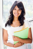 Latin college student. Beautiful young latin female college student by the window Royalty Free Stock Photos