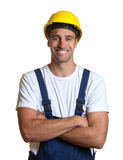 Latin construction worker with crossed arms Royalty Free Stock Image