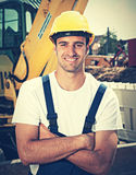 Latin construction worker with earth mover work place in vintage Stock Photos