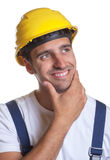 Latin construction worker solving a problem Royalty Free Stock Photography