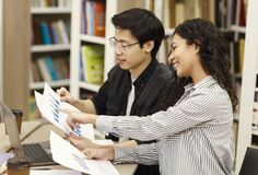 Free Latin Counselor Explaining Charts And Diagrams To Student Stock Photo - 172757800