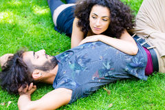 Latin Couple on meadow sleeping in summer Royalty Free Stock Photography