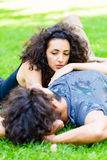 Latin Couple on meadow sleeping in summer Stock Photography