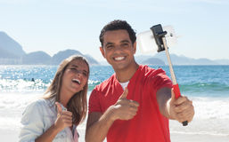 Latin couple showing thumb and taking selfie with phone Royalty Free Stock Photos
