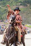 Portrait Of A Young Hispanic Cowboy Throwing A Lasso Royalty Free Stock Image