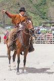Old  Latin cowboy riding a horse Stock Photos