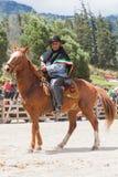 Old  Latin cowboy riding a horse Royalty Free Stock Photo
