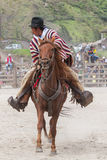 Young Latin cowboy riding a horse Stock Images