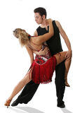 Latin dance. The young woman and the man dancing the American dance Royalty Free Stock Photos