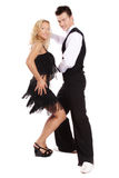 Latin dance. Beautiful blond and brunet dancing salsa on white background Royalty Free Stock Photo