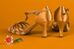 984388deb Latin dance shoes. With little flower decoration are on orange background  stock photos