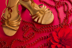 6fb347230 Latin dance shoes. With red pearls and rose on red background royalty free  stock photos