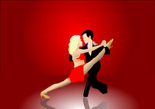 Latin Dancers. A pair of latin dancers on a stage with a red curtain and polished floor. The man is holding the woman in a latin dance pose. The additional Stock Photography
