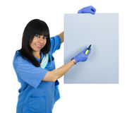 Latin doctor with surgical uniform. Holding a banner, isolated on white Royalty Free Stock Photo