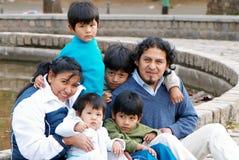 Latin family sitting in the street. Happy Latin family sitting in the street Stock Photos