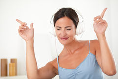 Latin female dancing while listening to music Royalty Free Stock Photos