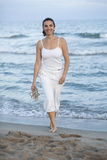 Latin female model on the beach Stock Photo