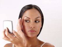 Latin female portrait looking in the mirror Royalty Free Stock Photo