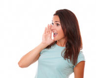 Latin female screaming to her right Royalty Free Stock Photo