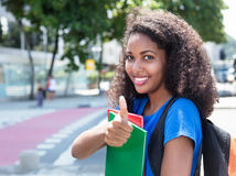 Latin female student with curly hair showing thumb up Royalty Free Stock Photography
